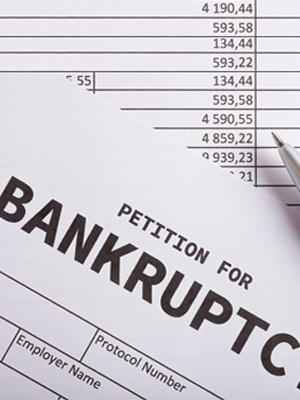 File bankruptcy to avoid paying tax on the cancelled debt.